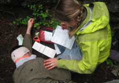 Wilderness First Responder student completing a patient history.