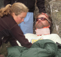 Wilderness First Aid student completing a physical exam on a trauma patient.